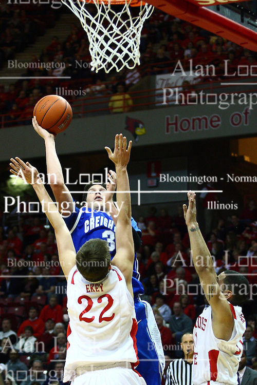 13 January 2012:  Doug McDermott shoots a fader to get past the arms of Jon Ekey during an NCAA Missouri Valley Conference mens basketball game where the Creighton Bluejays topped the Illinois State Redbirds 87-78 in Redbird Arena, Normal IL