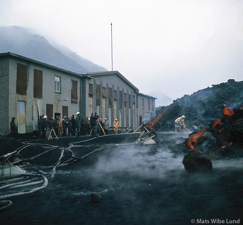 Heimaey 1973. Hraunið nálgast Rafstöðinn.Heimaey volcanic eruption 1973 - Westman Island..Trying to stop the lavaflow from flowing over the Electrisity Plant.