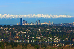 United States, Washington. Lake Washington, Mercer Island, Seattle skyline, and Olympic mountains viewed from Bellevue.