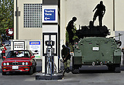 The crew of a Canadian Coyote armoured recon vehicle stop at local gas station to fuel up in Vancouver, BC. (2003)