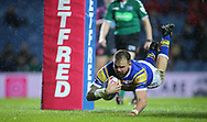 Adam Cuthbertson of Leeds Rhinos dives to score the 1st try of the game against Hull Kingston Rovers during the Betfred Super League match at Elland Road, Leeds<br /> Picture by Stephen Gaunt/Focus Images Ltd +447904 833202<br /> 08/02/2018