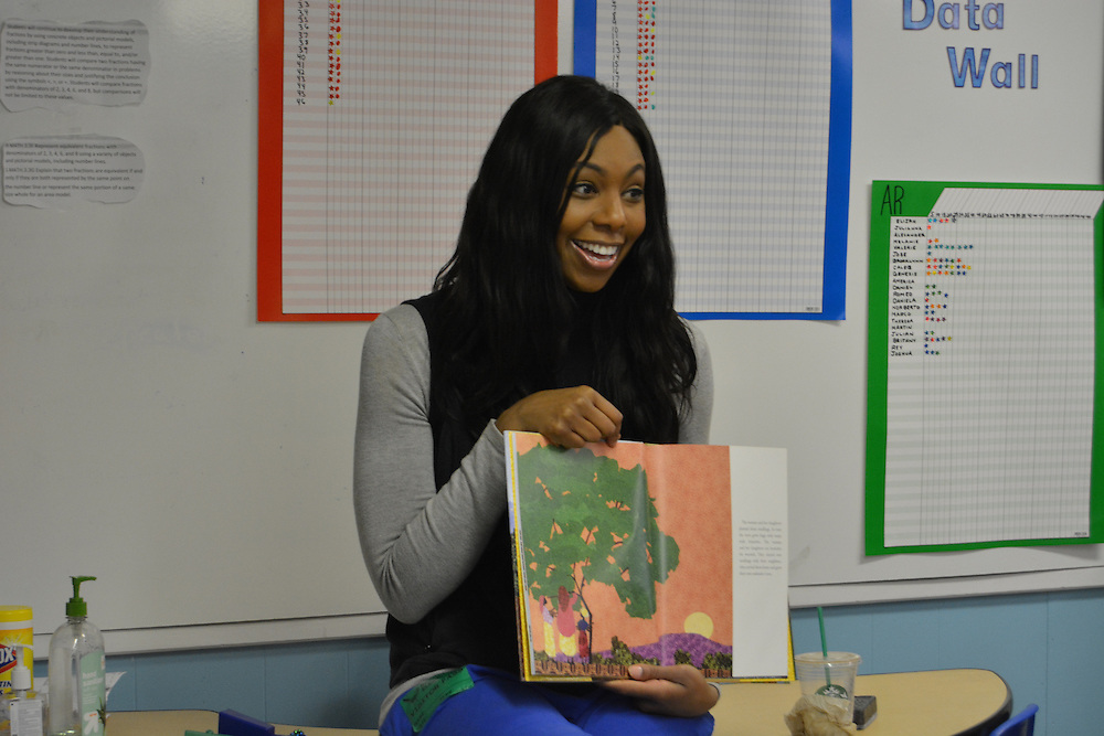 Reading with the Pros: Former basketball star Chantelle Anderson reads Mama Miti to third-graders in their classroom.