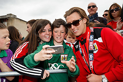 Luke Freeman takes a selfie with fans in Lloyds Amphitheatre during the Bristol City open top bus parade to celebrate winning both the League 1 and Johnstone's Paint Trophy titles this season and promotion to the Championship - Photo mandatory by-line: Rogan Thomson/JMP - 07966 386802 - 04/05/2015 - SPORT - FOOTBALL - Bristol, England - Bristol City Bus Parade.