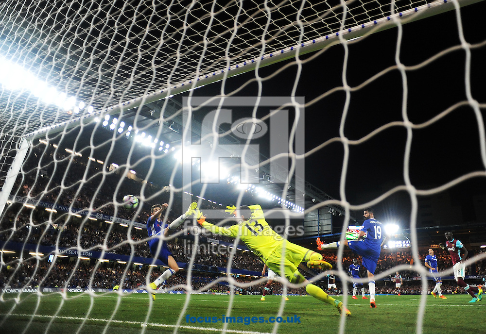 Chelsea goalkeeper Thibaut Courtois is unable to stop James Collins of West Ham United scoring their first goal during the Premier League match at Stamford Bridge, London<br /> Picture by Daniel Hambury/Focus Images Ltd +44 7813 022858<br /> 15/08/2016
