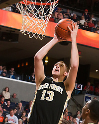 Wake Forest center Chas McFarland (13) shoots a layup against UVA.  The Virginia Cavaliers fell to the #13 ranked Wake Forest Demon Deacons 70-60 at the John Paul Jones Arena on the Grounds of the University of Virginia in Charlottesville, VA on February 28, 2009.