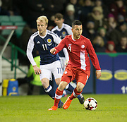 Canada&rsquo;s Marco Bustos and Scotland&rsquo;s Steven Naismith  - Scotland v Canada, friendly international at EasterRoad, Edinburgh.Photo: David Young<br /> <br />  - &copy; David Young - www.davidyoungphoto.co.uk - email: davidyoungphoto@gmail.com