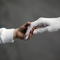childs hand touching adult hand