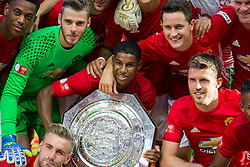 Marcus Rashford holds the Community Shield as he celebrates with his teammates after Manchester United win the match 1-2 - Rogan Thomson/JMP - 07/08/2016 - FOOTBALL - Wembley Stadium - London, England - Leicester City v Manchester United - The FA Community Shield.