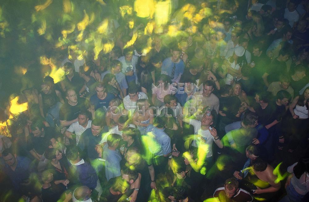 Crowd bathed in yellow light dancng at Sugar Shack Middlesborough April 2002
