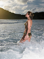 Thailand young woman walking in sea
