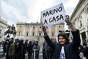 Roma 25th feb 2015, leader and parliamentarians of Lega Nord party, demonstrates at Campidoglio's Square, demanding the resignation of mayor of Rome. In the picture some demonstrators holds a sign reading ' Marino go Home '