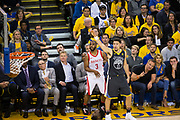 Golden State Warriors guard Klay Thompson (11) watches as a three pointer shot by Golden State Warriors forward David West (3) goes through the net during Game 4 of the Western Conference Finals at Oracle Arena in Oakland, Calif., on May 22, 2018. (Stan Olszewski/Special to S.F. Examiner)