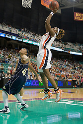 Virginia center Aisha Mohammed (33) jumps for an easy layup against GT.  The #4 seed/#25 ranked Virginia Cavaliers women's basketball team defated the #5 seed Georgia Tech Yellow Jackets 52-43 in the quarterfinals of the 2008 ACC Women's Basketball Tournament at the Greensboro Coliseum in Greensboro, NC on March 7, 2008.