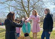 North Merrick, New York, USA. March 31, 2018.  Hempstead Town Supervisor LAURA GILLEN (wearing pink coat) shakes hands with ALISON FRANKEL, the President of South Bellmore Civic Association, at the 16th Annual Eggstravaganza, held at Fraser Park.