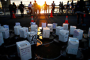 People and a cluster of hand made lanterns awaiting sunset next to the Hudson river in New York, Today Monday Sep 11 2006. A traditional floating lanterns ceremony commemorating the fifth anniversary of  the WTC victims, sponsored by the New York Buddhist Church.