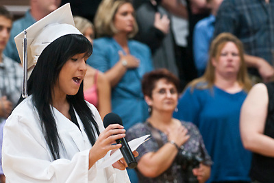 Lathan Goumas | MLive.com..Kaytlin Fletcher sings the National Anthem during the 2012 Atherton High School commencement ceremony at Atherton High School in Burton, Mich. on Sunday June 3, 2012.