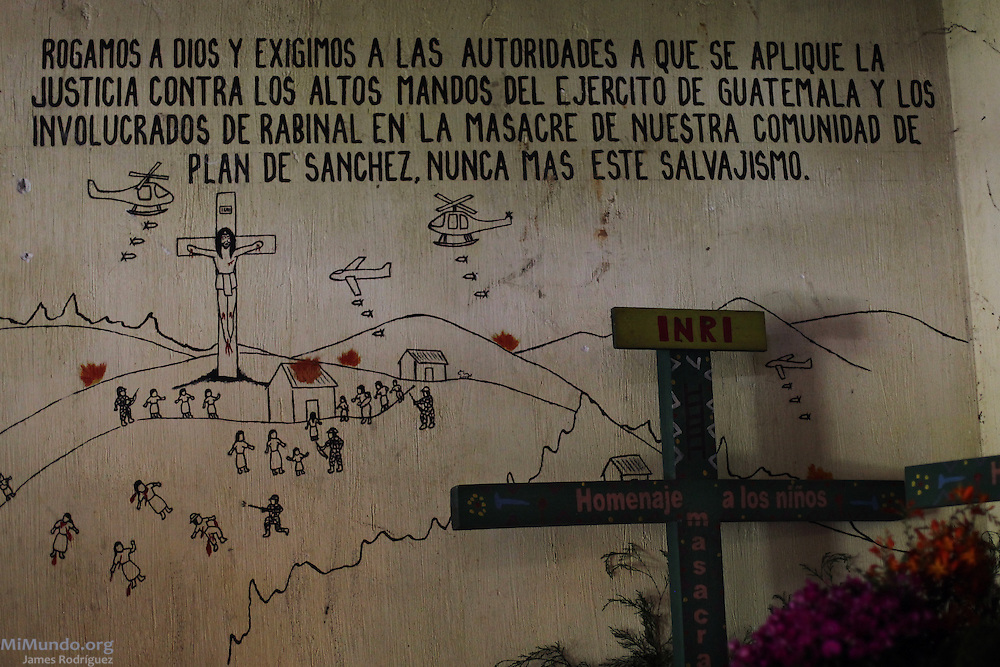 "A wall inside the chapel that commemorates those killed in Plan de Sanchez displays a mural representation of the massacre that reads: ""We pray to God and demand the authorities to apply justice against the high ranking officers from the Guatemalan Army and those from Rabinal involved in the massacre of our community of Plan de Sanchez. Never again such savagery."" On July 18, 1982, Guatemalan soldiers and members of the right-wing paramilitary Civil Self-Defense Patrols (Patrullas de Autodefensa Civil, or PACs) brutally massacred 268 people in Plan de Sanchez, a remote Achi Mayan hamlet near Rabinal town. The event occurred during the scorched earth campaigns carried out by the de facto government of general Efraín Ríos Montt. On March 21, 2012, five former members of the PACs were each sentenced to 7710 years in prison for their participation in the massacre. Plan de Sánchez Hamlet, Rabinal, Baja Verapaz, Guatemala. July 21, 2012."
