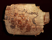 Cuneiform tablet (Assyrian) from Iraq circa 3000 BC. This is a tablet contains circles and half circles which depict numerals listing quantities of traded commodities.