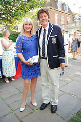 MIKE READ and EILEEN JOHNSTON at the Lord's Taverners Diamond Jubilee Garden Party held in College Gardens, Westminster Abbey, London on 8th July 2010.