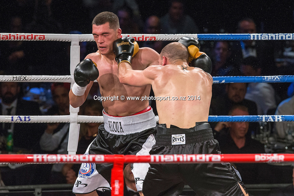 David Aloua (L) fights Anthony McCrackenin the Mahindra Super 8 Fight Night, North Shore Events Centre, Auckland, New Zealand, Saturday, November 22, 2014. Photo: David Rowland/Photosport