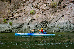 Kayaking, no model release, on the Colorado River below Hoover Dam on border of Arizona, AZ, Nevada, NV, tourism, vacation, sports, action, image nv420-18644.Photo copyright: Lee Foster, www.fostertravel.com, lee@fostertravel.com, 510-549-2202