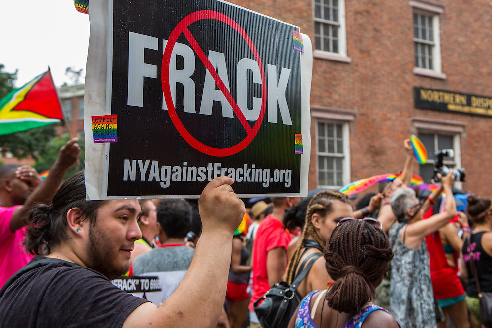"A man from New York Against Fracking carries a ""No frack"" sign. Many New York state residents are against permitting hydraulic fracturing for oil in the state."