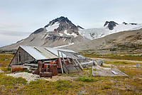 Derelict mining cabin at Athelney Pass, in the distance is Mount Ethelweard 2819 m (9249 ft), Coast Range British Columbia Canada