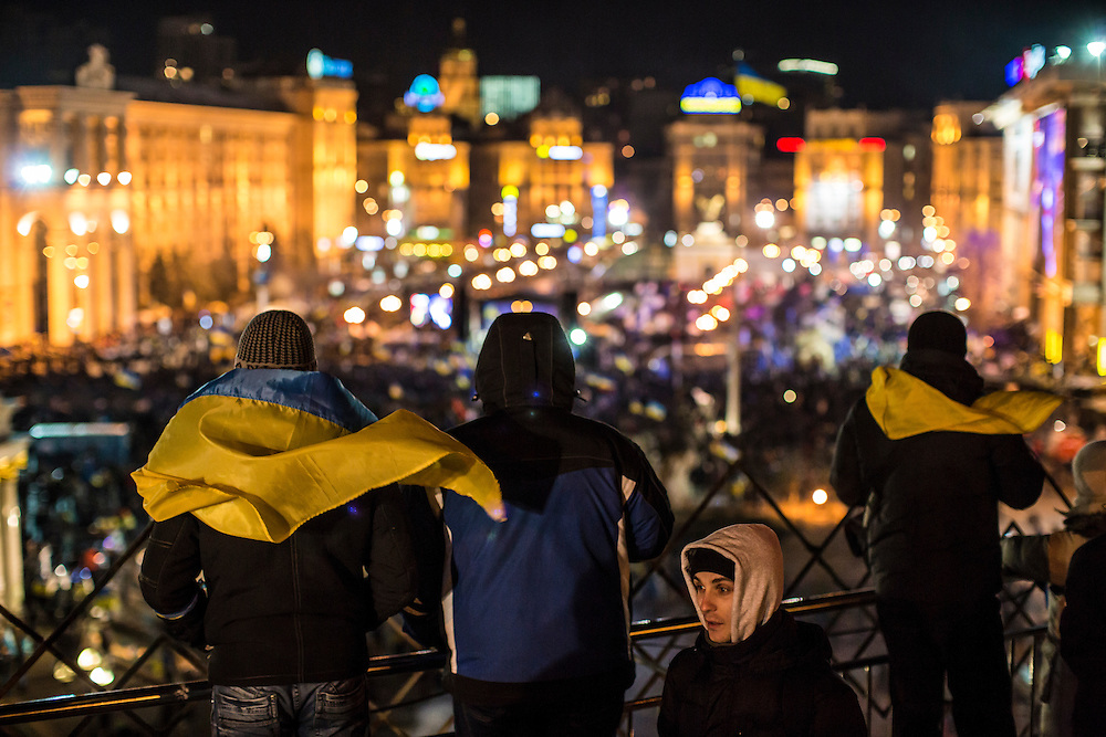 KIEV, UKRAINE - DECEMBER 3: Protesters look out over an anti-government rally in Independence Square on December 3, 2013 in Kiev, Ukraine. Thousands of people have been protesting against the government since a decision by Ukrainian president Viktor Yanukovych to suspend a trade and partnership agreement with the European Union in favor of incentives from Russia. (Photo by Brendan Hoffman/Getty Images) *** Local Caption ***