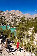 Hiker above Big Pine Lake #3, John Muir Wilderness, Sierra Nevada Mountains, California USA