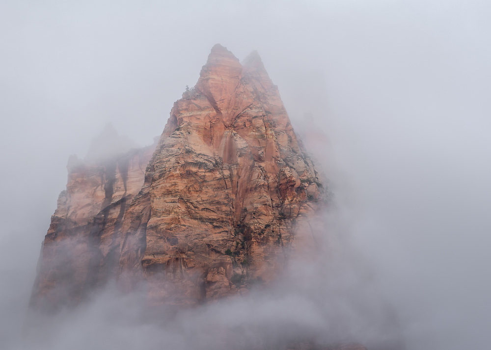 Zion with its towering red rock is even more impressive when blanketed by fogs and low clouds. Indeed, what the eyes don't see, the heart completes.