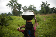 Clean drinking water along the mining belts is scarce and villagers have to travel far. Sukinda, Orissa, India.