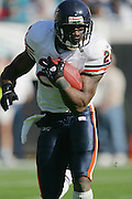 JACKSONVILLE, FL - DECEMBER 12:  Though he caught 3 passes for 68 yards, running back Thomas Jones #20 of the Chicago Bears ran the ball 13 times for only 26 yards rushing against the Jacksonville Jaguars on December 12, 2004 at Alltel Stadium in Jacksonville, Florida. The Jags defeated the Bears 22-3. ©Paul Anthony Spinelli *** Local Caption *** Thomas Jones