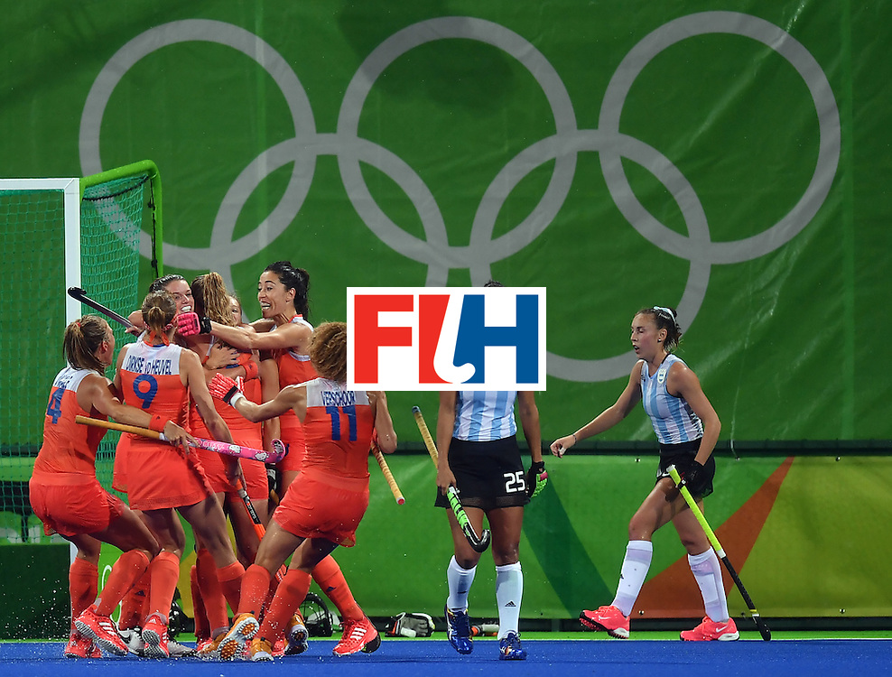 Netherland's players celebrate their second goal during the women's quarterfinal field hockey Netherland vs Argentina match of the Rio 2016 Olympics Games at the Olympic Hockey Centre in Rio de Janeiro on August 15, 2016.  / AFP / MANAN VATSYAYANA        (Photo credit should read MANAN VATSYAYANA/AFP/Getty Images)