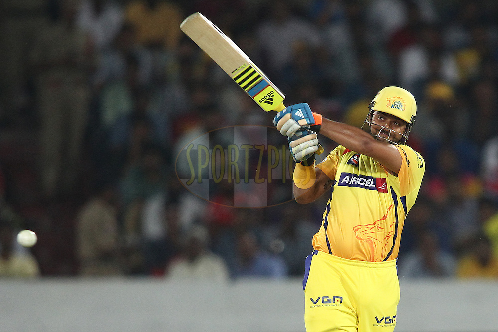 Suresh Raina of the Chennai Super Kings pulls a delivery straight to Kings XI Punjab captain George Bailey during the second semi final match of the Oppo Champions League Twenty20 between the Kings XI Punjab and the Chennai Superkings held at the Rajiv Gandhi Cricket Stadium, Hyderabad, India on the 2nd October 2014<br /> <br /> Photo by:  Shaun Roy / Sportzpics/ CLT20<br /> <br /> <br /> Image use is subject to the terms and conditions as laid out by the BCCI/ CLT20.  The terms and conditions can be downloaded here:<br /> <br /> http://sportzpics.photoshelter.com/gallery/CLT20-Image-Terms-and-Conditions-2014/G0000IfNJn535VPU/C0000QhhKadWcjYs