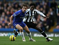 Photo: Lee Earle.<br /> Chelsea v Newcastle United. The Barclays Premiership.<br /> 19/11/2005. Chelsea's Joe Cole (L) holds off Celestine Babayaro.