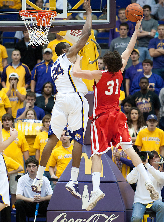 Nicholls State Colonels g-f Anatoly Bose (31) shoots a basket during the second half of the game. Nicholls State Colonels defeated LSU 62-53.