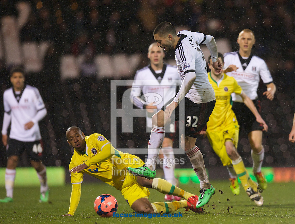 Picture by Alan Stanford/Focus Images Ltd +44 7915 056117<br /> 04/02/2014<br /> Clint Dempsey of Fulham and Matthew Hill of Sheffield United during the The FA Cup match at Craven Cottage, London