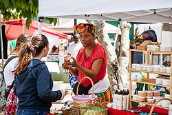 "Aquannette Chinnery allows customers to smell her wares.  ""Alvin's Cultural Workshop"" Cultural Fair honoring Mr. Alvin Turnbull.  Emancipation Garden.  St. Thomas, VI.  29 April 2015.  © Aisha-Zakiya Boyd"