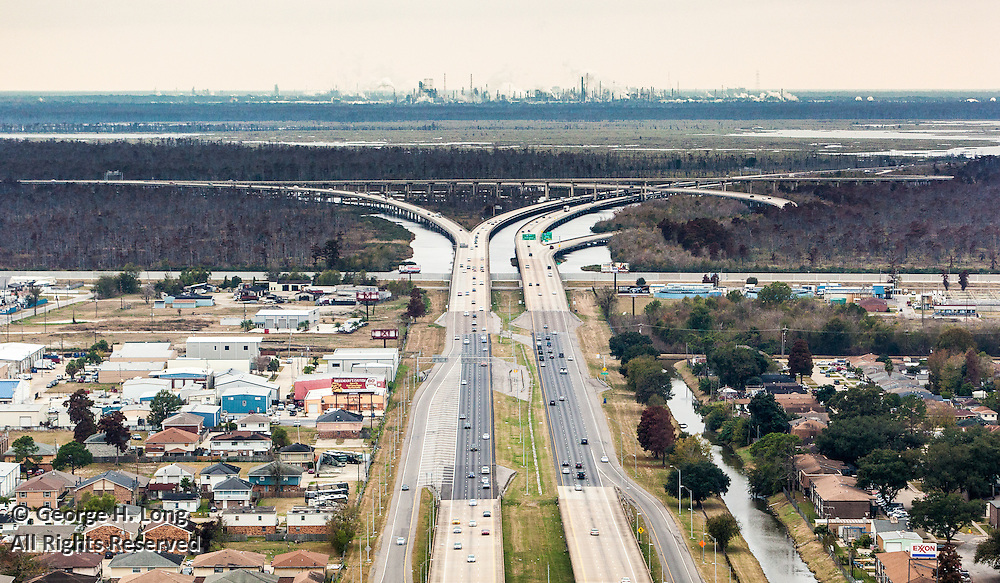 aerial view from Kenner, Louisiana of Interstates 10 and 310 with Norco Refinery in distance