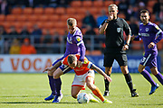 Jay Spearing of Blackpool is fouled by Andy Cannon of Portsmouth during the EFL Sky Bet League 1 match between Blackpool and Portsmouth at Bloomfield Road, Blackpool, England on 31 August 2019.