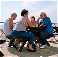 A family eat fish and chips near the Camber Sands Beach and Holiday Park.