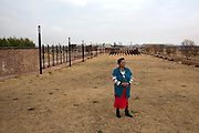 Vuyiswa Moalosi, 58, pictured beside the Sharpeville Memorial,built in honour of the 69 people killed in the Sharpeville massacre of March 1960, in Sharpeville, South Africa. The massacre led to anti-apartheid organisations like the ANC taking up armed resistance. President Nelson Mandela chose Sharpeville for the signing into law of the Constitution of South Africa on 10 December 1996.