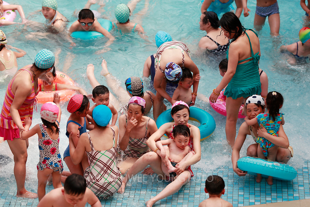North Koreans enjoy a national holiday in the Munsu Water Park as part of celebrations of the 'Day of the Sun', commemorating the 105th birth anniversary of late supreme leader Kim Il-sung in Pyongyang, North Korea, 16 April 2017. A North Korean missile exploded within seconds of its launch on the east coast on 16 April, South Korean and US officials say as tensions rise in the region over nuclear issues.