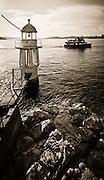 Sydney Ferry 'Fishburn' passing Cremorne Point in early morning light. Sydney Harbour, Sydney, Australia
