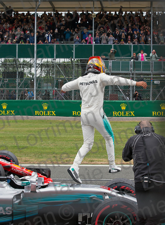 The 2017 Formula 1 Rolex British Grand Prix at Silverstone Circuit, Northamptonshire.<br /> <br /> Pictured: Mercedes AMG Petronas Driver Lewis Hamilton celebrates qualifying in pole position at the British F1 Grand Prix.<br /> <br /> Jamie Lorriman<br /> mail@jamielorriman.co.uk<br /> www.jamielorriman.co.uk<br /> +44 7718 900288