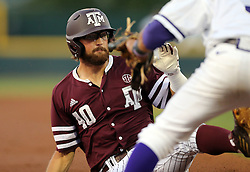 Texas A&M's Jonathan Moroney (40) slides safely into third base under the tag of TCU's Elliott Barzilli (3) during the first inning of a NCAA college baseball Super Regional tournament game, Saturday, June 11, 2016, in College Station, Texas. (AP Photo/Sam Craft)