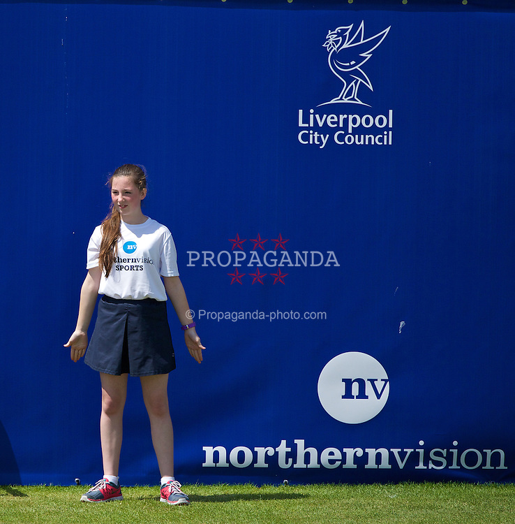 LIVERPOOL, ENGLAND - Sunday, June 22, 2014: A ball-girl during Day Four of the Liverpool Hope University International Tennis Tournament at Liverpool Cricket Club. (Pic by David Rawcliffe/Propaganda)