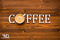 Coffee spelled on wooden background