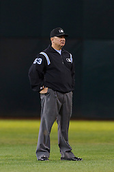 September 20, 2011; Oakland, CA, USA;  MLB umpire Greg Gibson (53) stands in the outfield during the fifth inning between the Oakland Athletics and the Texas Rangers at O.co Coliseum.  Texas defeated Oakland 7-2.