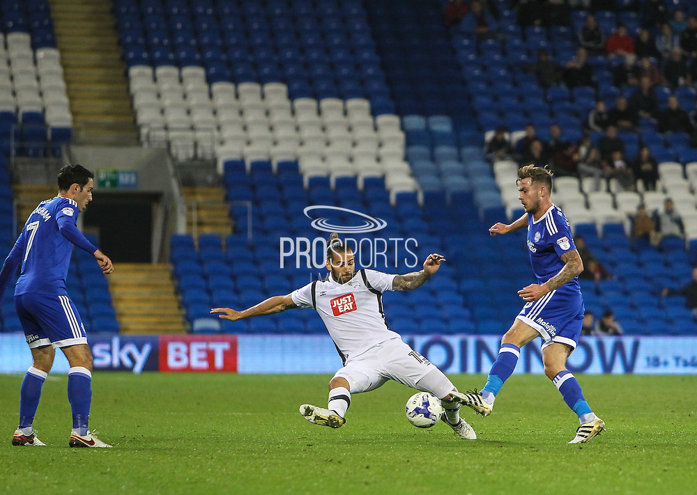 Bradley Johnson of Derby County dives in to tackle Joe Ralls of Cardiff City during the EFL Sky Bet Championship match between Cardiff City and Derby County at the Cardiff City Stadium, Cardiff, Wales on 27 September 2016. Photo by Andrew Lewis.